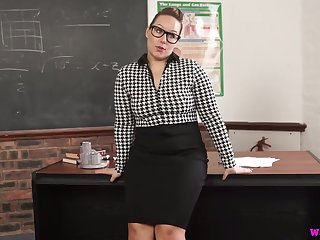 Ample breasted teacher Ashley Rider is masturbating cunt ob the table
