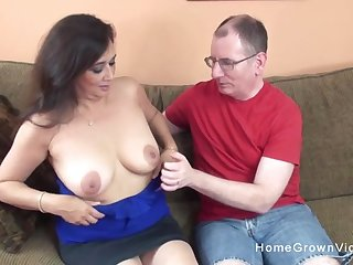 Busty milf sucks his cock the lays back and lets him stuff her shaved pussy!