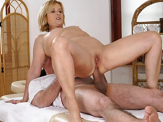 Older woman enjoys massage and anal sex