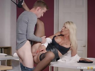 Milf in a leather mini skirt needs that huge cock inside her
